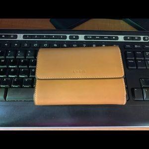 Lodis tan trifold wallet
